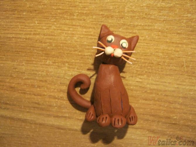 Игривый кот из пластилина шаг 17