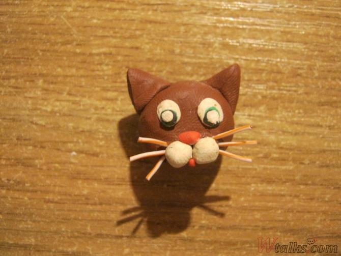 Игривый кот из пластилина шаг 9